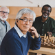 group of happy senior friends playing chess together - PhotoDune Item for Sale