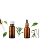 Horizontal seamless flat lay background of dropper and spray bottles with oil and herbs - PhotoDune Item for Sale