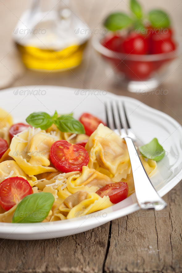 tortellini with cheese and tomatoes - Stock Photo - Images