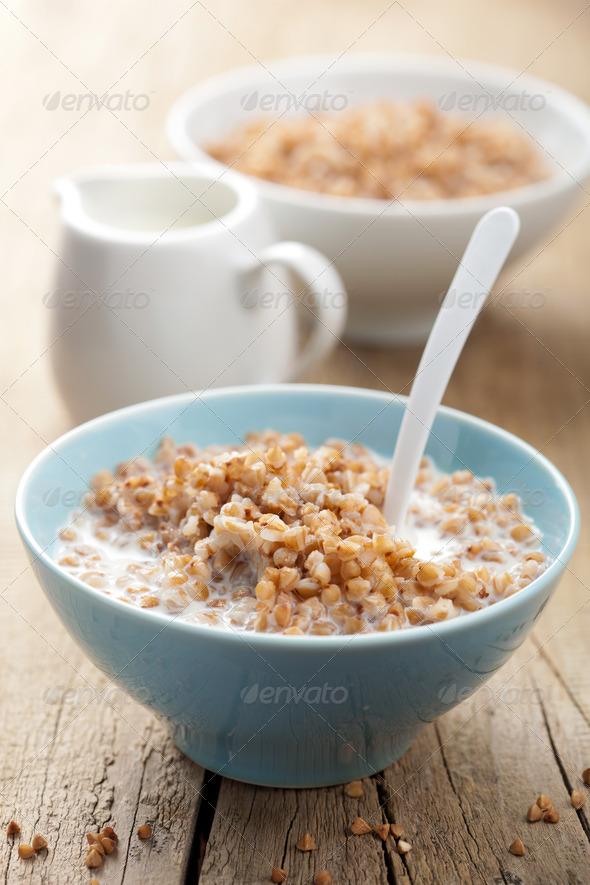 buckwheat groats with milk - Stock Photo - Images