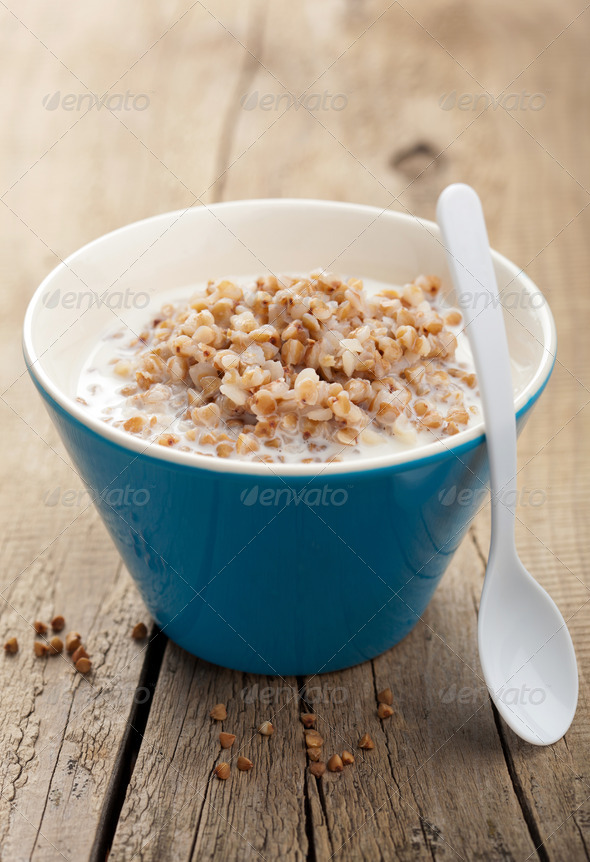 buckwheat groats with milk - Stock Photo - Images