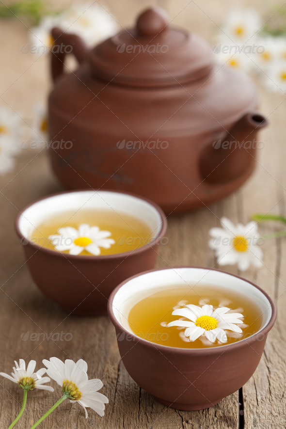 green tea with chamomile flowers - Stock Photo - Images