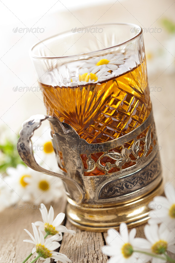 cup of herbal tea with chamomile flowers - Stock Photo - Images