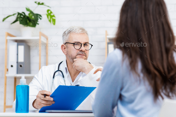 Consult patient in private hospital, diagnostics and medical exam - Stock Photo - Images