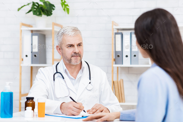 Regular checkup examine in modern clinic, family doctor and pharmaceutical - Stock Photo - Images