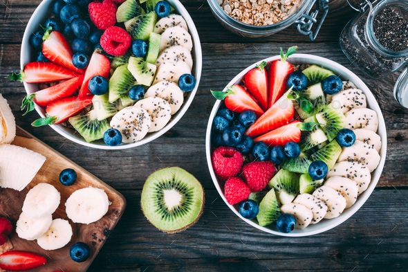 Healthy fresh fruit and berry salad with blueberry, strawberry, kiwi, raspberry, banana - Stock Photo - Images