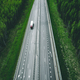 Aerial view of toll road highway with cars and trucks through green forest - PhotoDune Item for Sale