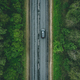 Aerial view of country road with car driving through green forest and corn fields - PhotoDune Item for Sale