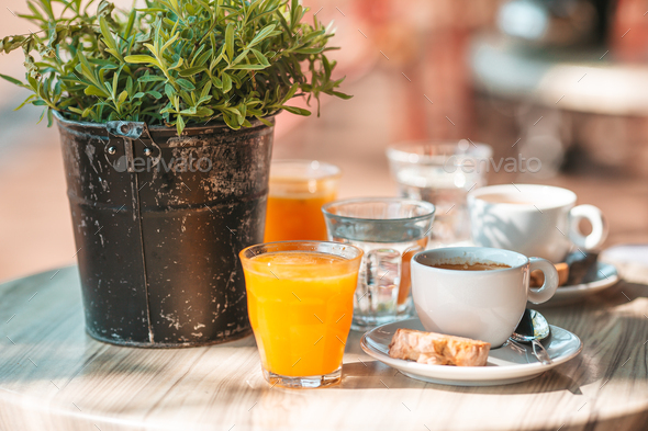 Fresh and delisious breakfast in outdoor cafe at european city - Stock Photo - Images