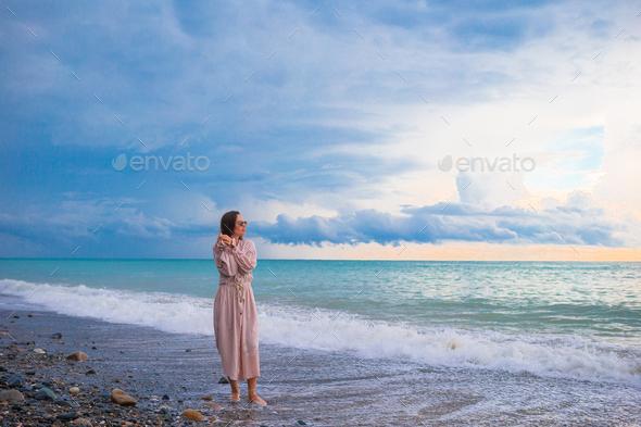 Woman on the beach enjoying summer holidays - Stock Photo - Images