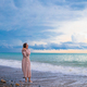 Woman on the beach enjoying summer holidays - PhotoDune Item for Sale