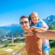 Beautiful happy family in mountains in the background of fog - PhotoDune Item for Sale