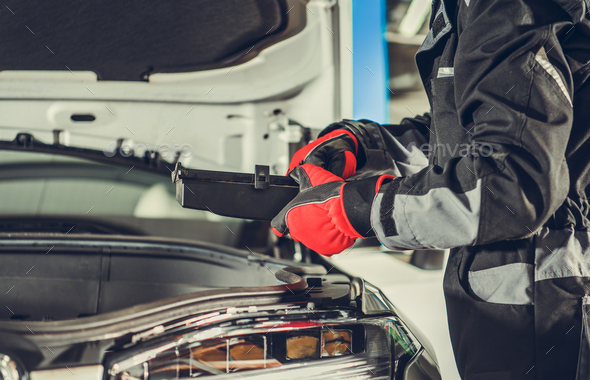 Car Mechanic Looking For Burned Fuse Under Vehicle Hood - Stock Photo - Images