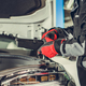 Car Mechanic Looking For Burned Fuse Under Vehicle Hood - PhotoDune Item for Sale