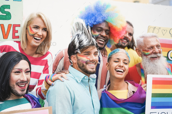 Multi generational people celebrating at gay pride event - Main focus on drag queen face - Stock Photo - Images