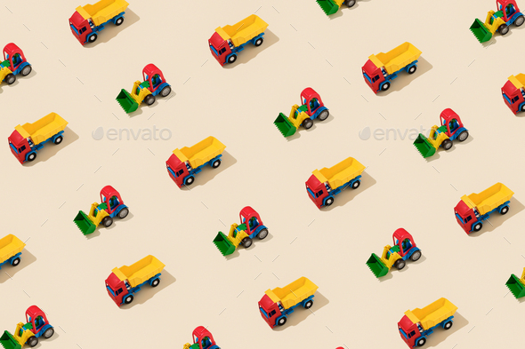 Truck and Tractor Creative Pattern on Yellow Background - Stock Photo - Images