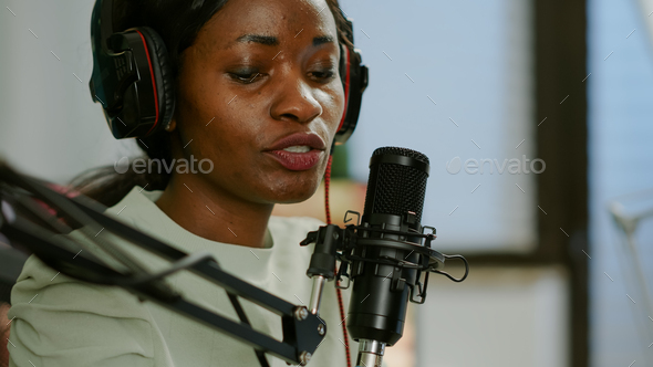 Close up of afro woman vlogger making new video blog - Stock Photo - Images