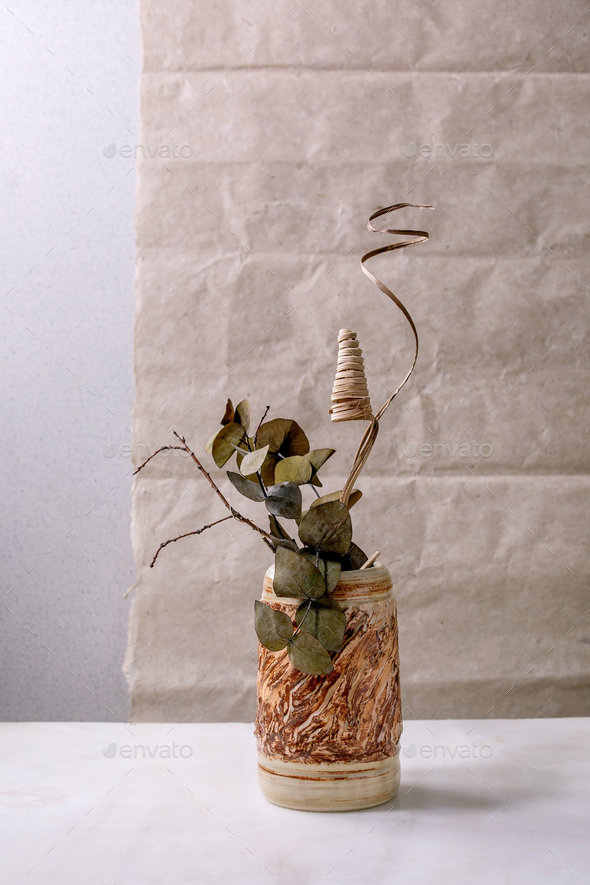 Dry flowers and twigs branch in ceramic vase - Stock Photo - Images