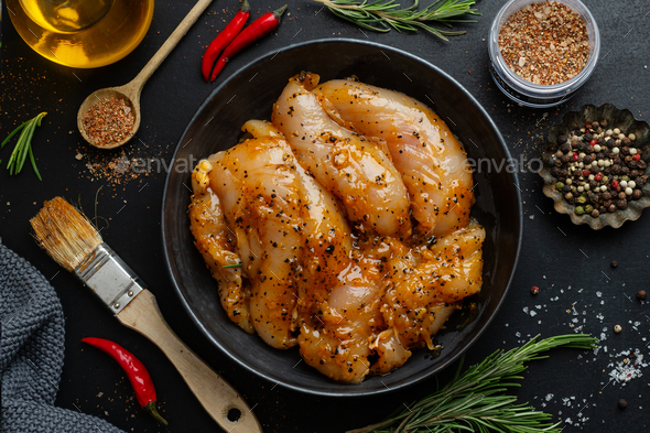 Raw chicken breast marinated with spices - Stock Photo - Images
