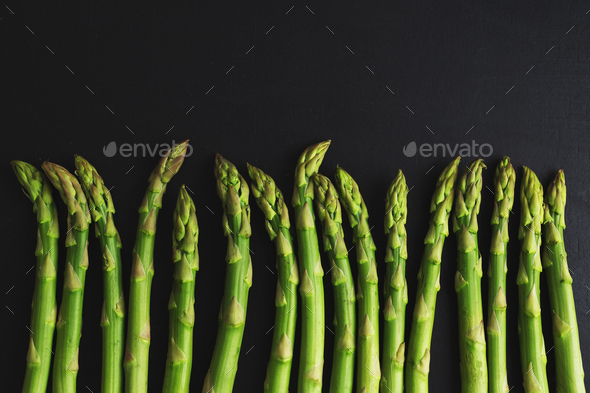 Green asparagus on dark background - Stock Photo - Images