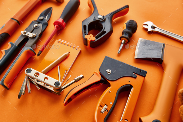 Professional workshop instrument, red background - Stock Photo - Images