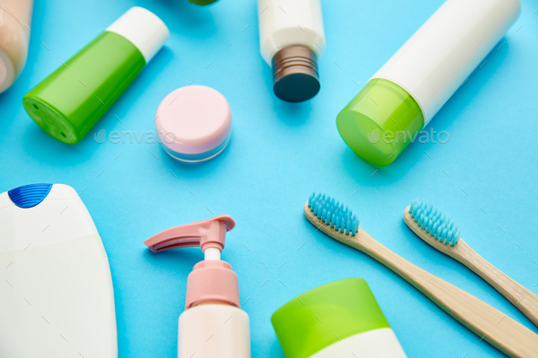 Oral and skin care products, blue background - Stock Photo - Images