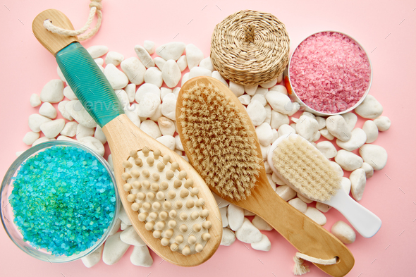 Skin care products on pebbles, pink background - Stock Photo - Images