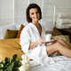 Beautiful woman with coffee in bed and roses - PhotoDune Item for Sale