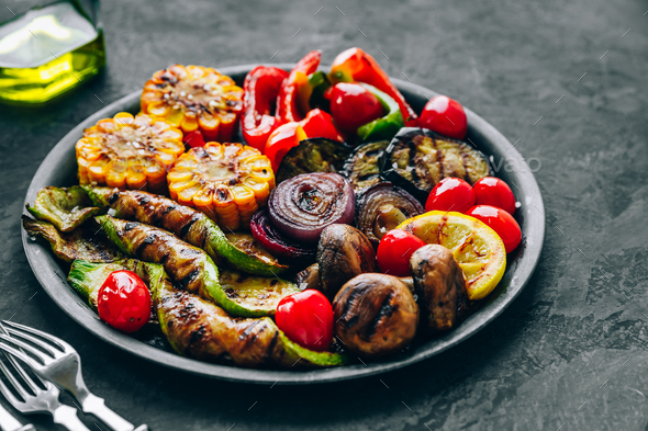 Grilled vegetables in bowl on dark stone background. - Stock Photo - Images