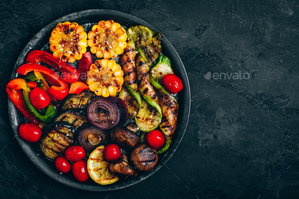 Grilled vegetables in bowl on dark stone background, top view. - Stock Photo - Images