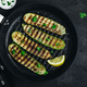 Grilled zucchini slices in cast iron pan on dark stone or concrete background - PhotoDune Item for Sale