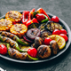Grilled vegetables in bowl on dark stone background. - PhotoDune Item for Sale