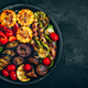 Grilled vegetables in bowl on dark stone background, top view. - PhotoDune Item for Sale