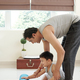 Father and son rolling out yoga mat - PhotoDune Item for Sale