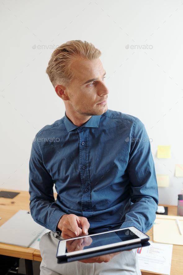Handsome entrepreneur with digital tablet - Stock Photo - Images