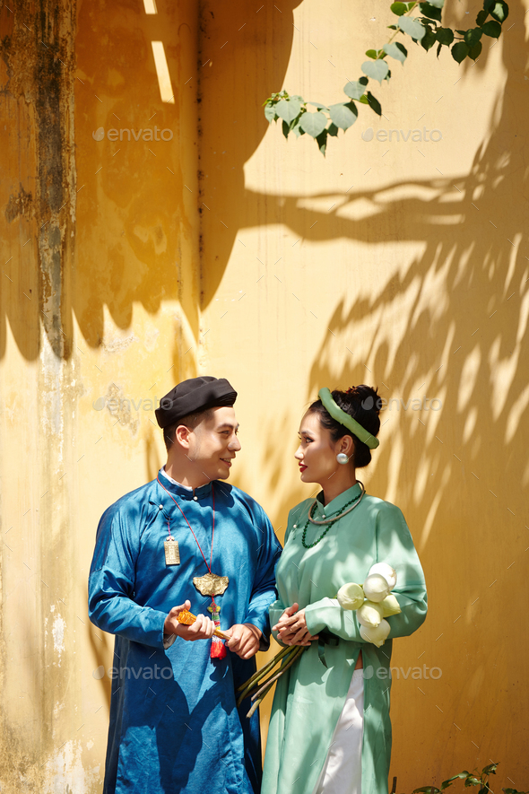 Veitnamese couple in traditional dresses - Stock Photo - Images