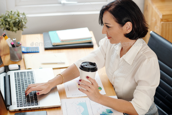 Female entrepreneur working on laptop - Stock Photo - Images