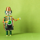 Steampunk style mechanical robot toy with a funny copper hat and green empty interface on body. - PhotoDune Item for Sale