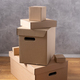 Stack of cardboard box on floor. Cardboard boxes for moving to new home. Relocation concept - PhotoDune Item for Sale