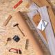 Laminate floor on osb wood background texture and tools. Wooden laminate floor plank - PhotoDune Item for Sale