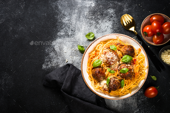Pasta with Meatballs in tomato sauce at black - Stock Photo - Images