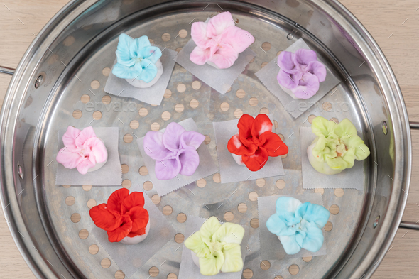 Chinese style colorful flower dumplings before steaming - Stock Photo - Images