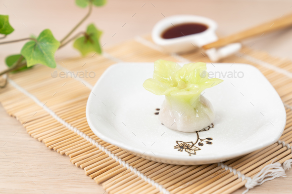 Chinese yellow color flower dumpling or dim sum - Stock Photo - Images