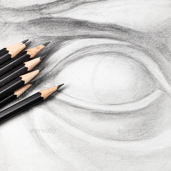 square view of graphite pencils on drawing of eye - Stock Photo - Images