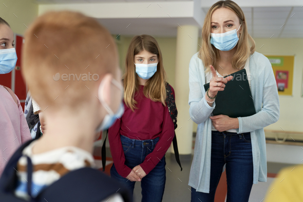 Teacher reprimands a student at school during a pandemic - Stock Photo - Images