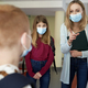 Teacher reprimands a student at school during a pandemic - PhotoDune Item for Sale