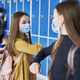 Girls wearing protective masks and having an elbow greeting - PhotoDune Item for Sale
