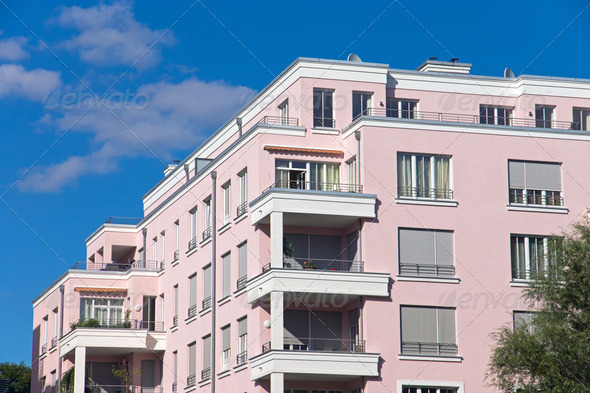 Beautiful pink apartment house - Stock Photo - Images