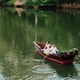 a boat trip for a guy and a girl along the canals and bays of the river - PhotoDune Item for Sale