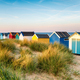 Pretty beach huts in the sand dunes - PhotoDune Item for Sale